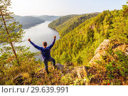 Купить «A tourist admires the picturesque view from above on the Yumaguzinsky reservoir on the Belaya River. Bashkortostan.», фото № 29639991, снято 31 августа 2018 г. (c) Акиньшин Владимир / Фотобанк Лори