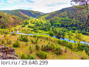 Купить «View from above. Far below is a picturesque parking on the river bank among the mountains and taiga. The nature of the Urals.», фото № 29640299, снято 5 сентября 2018 г. (c) Акиньшин Владимир / Фотобанк Лори