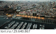 Купить «View from drones of sailboats and yachts in old port of Barcelona and gothic quarter at night», видеоролик № 29640867, снято 28 сентября 2018 г. (c) Яков Филимонов / Фотобанк Лори