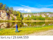 Купить «Tourist admires the picturesque view of the rocky shore of the river. The nature of the Urals.», фото № 29644559, снято 7 сентября 2018 г. (c) Акиньшин Владимир / Фотобанк Лори
