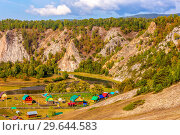 Купить «Panoramic scenic view from above of the Ural village on the banks of the river among the mountain peaks and taiga. The nature of the Urals.», фото № 29644583, снято 7 сентября 2018 г. (c) Акиньшин Владимир / Фотобанк Лори