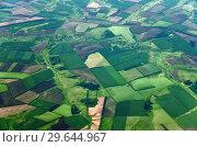 Купить «Farmland from great height in the Krasnodar Territory of Russia», фото № 29644967, снято 29 мая 2018 г. (c) Володина Ольга / Фотобанк Лори