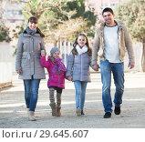 Купить «Parents with kids walking in the street», фото № 29645607, снято 23 февраля 2019 г. (c) Яков Филимонов / Фотобанк Лори