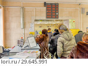 Купить «Russia, Samara, February 2017: unemployed citizens in the employment service in search of work. Text in Russian: language municipal enterprise accomplishment, job offer», фото № 29645991, снято 20 февраля 2017 г. (c) Акиньшин Владимир / Фотобанк Лори