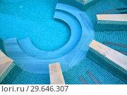 Купить «Descent to the pool made in shape of a semicircle», фото № 29646307, снято 3 ноября 2018 г. (c) Володина Ольга / Фотобанк Лори