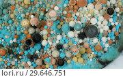 Купить «Colorful paint in bubbles organically moves in the liquid», видеоролик № 29646751, снято 5 июля 2020 г. (c) Dzmitry Astapkovich / Фотобанк Лори
