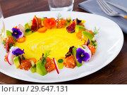 Купить «Fish tartare with fruits, vegetables, flowers in shape of ring», фото № 29647131, снято 15 ноября 2019 г. (c) Яков Филимонов / Фотобанк Лори