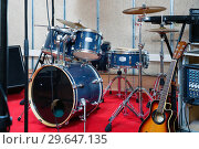 Купить «Set of musical instruments ready for rehearsal of music band in modern sound studio», фото № 29647135, снято 26 октября 2018 г. (c) Яков Филимонов / Фотобанк Лори