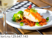 Купить «Tasty fried salmon on a pillow of smoked carrots, broccoli and fig on plate», фото № 29647143, снято 14 октября 2019 г. (c) Яков Филимонов / Фотобанк Лори