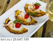 Купить «Cooked at grill sepia with pineapple, cherry tomatoes and with sweet-sour sauce», фото № 29647199, снято 18 января 2019 г. (c) Яков Филимонов / Фотобанк Лори
