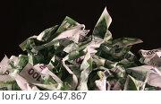 Купить «A bunch of crumpled one hundred Euro banknotes rotate on a black background close-up», видеоролик № 29647867, снято 31 декабря 2018 г. (c) Алексей Кузнецов / Фотобанк Лори