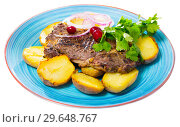 Juicy beefsteak served with baked potato. Стоковое фото, фотограф Яков Филимонов / Фотобанк Лори