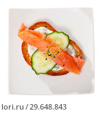 Купить «Toasted bread with creamy sauce, salmon and cucumber», фото № 29648843, снято 25 мая 2019 г. (c) Яков Филимонов / Фотобанк Лори