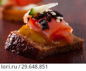 Купить «Close up image of canape with salmon», фото № 29648851, снято 23 марта 2019 г. (c) Яков Филимонов / Фотобанк Лори