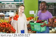 Купить «Smiling couple is standing with basket», фото № 29659027, снято 26 мая 2018 г. (c) Яков Филимонов / Фотобанк Лори