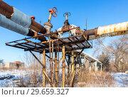 Купить «Old rusty pipeline with valves against the blue sky background», фото № 29659327, снято 10 февраля 2018 г. (c) FotograFF / Фотобанк Лори