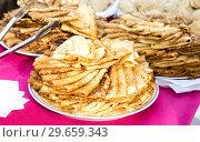 Купить «Appetizing fried pancakes on the Pancake Week», фото № 29659343, снято 18 февраля 2018 г. (c) FotograFF / Фотобанк Лори