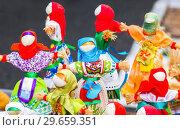 Купить «Traditional handmade straw dolls gift on the Shrovetide carnival. Maslenitsa or Pancake Week in the Russia», фото № 29659351, снято 18 февраля 2018 г. (c) FotograFF / Фотобанк Лори
