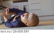 Купить «Baby girl rolling on the floor at home», видеоролик № 29659591, снято 24 июня 2019 г. (c) Данил Руденко / Фотобанк Лори
