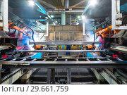 Купить «Welding robot, the process of welding a metal profile.», фото № 29661759, снято 27 сентября 2018 г. (c) Андрей Радченко / Фотобанк Лори