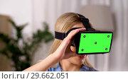 Купить «happy young woman in vr glasses at home», видеоролик № 29662051, снято 21 февраля 2019 г. (c) Syda Productions / Фотобанк Лори