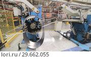 Купить «Cold rolled steel coil on decoiler of machine in metalwork manufacturing», видеоролик № 29662055, снято 15 октября 2018 г. (c) Андрей Радченко / Фотобанк Лори