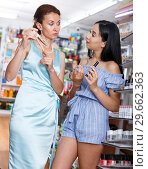 Купить «Woman and daughter looking new mascara in cosmetic store», фото № 29662363, снято 21 июня 2018 г. (c) Яков Филимонов / Фотобанк Лори