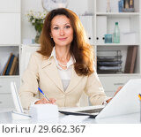 Portrait of young office woman who is working with laptop. Стоковое фото, фотограф Яков Филимонов / Фотобанк Лори