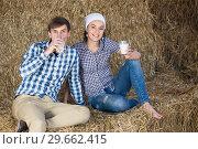 Купить «couple in the hay with milk», фото № 29662415, снято 18 апреля 2019 г. (c) Яков Филимонов / Фотобанк Лори