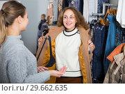 Купить «Women trying coat in clothing boutique», фото № 29662635, снято 6 декабря 2018 г. (c) Яков Филимонов / Фотобанк Лори
