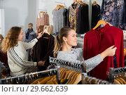Купить «Two women choosing new blouse», фото № 29662639, снято 6 декабря 2018 г. (c) Яков Филимонов / Фотобанк Лори