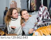 Купить «Women shopping in outerwear clothing boutique», фото № 29662643, снято 6 декабря 2018 г. (c) Яков Филимонов / Фотобанк Лори