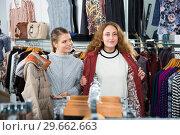 Купить «Woman trying new overcoat», фото № 29662663, снято 6 декабря 2018 г. (c) Яков Филимонов / Фотобанк Лори