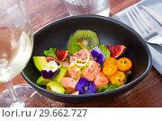 Купить «Ceviche of salmon with avocado, cumquat, kiwi fruit, figs», фото № 29662727, снято 21 октября 2019 г. (c) Яков Филимонов / Фотобанк Лори