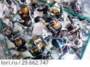 Close-up photo of variety baitcasting reel. Стоковое фото, фотограф Яков Филимонов / Фотобанк Лори