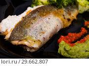 Купить «Grilled trout on black dish with broccoli and tartar sauce», фото № 29662807, снято 19 июня 2019 г. (c) Яков Филимонов / Фотобанк Лори