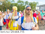 Купить «Russia, Samara, June 2018: football fans from Sweden wearing pigtail wigs at the World Cup», фото № 29664715, снято 7 июля 2018 г. (c) Акиньшин Владимир / Фотобанк Лори