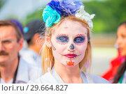 Купить «Russia, Samara, June 2018: Mexican cheerleaders decorated for the holiday Day of the Dead.», фото № 29664827, снято 2 июля 2018 г. (c) Акиньшин Владимир / Фотобанк Лори