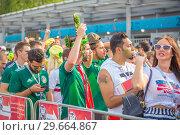 Купить «Russia, Samara, July 2018: Russian and Mexican football fans with national flags together communicate at the World Cup.», фото № 29664867, снято 2 июля 2018 г. (c) Акиньшин Владимир / Фотобанк Лори