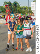 Russia, Samara, July 2018: beautiful Mexican fans in national clothes before the match Brazil Mexico for the World Cup. Редакционное фото, фотограф Акиньшин Владимир / Фотобанк Лори