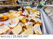 Купить «Tasty freshly cheese ready to sale in the showcase at the supermarket», фото № 29665047, снято 11 февраля 2018 г. (c) FotograFF / Фотобанк Лори