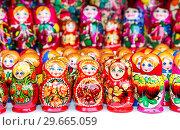 Купить «Russian traditional wooden doll - matryoshka», фото № 29665059, снято 18 февраля 2018 г. (c) FotograFF / Фотобанк Лори