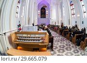 Купить «Interior of Roman Catholic parish of the sacred Heart of Jesus», фото № 29665079, снято 25 февраля 2018 г. (c) FotograFF / Фотобанк Лори