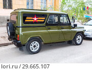 Купить «Special russian armored vehicle UAZ-3152 Hussar parked at the city street during the parade on Victory Day», фото № 29665107, снято 6 мая 2017 г. (c) FotograFF / Фотобанк Лори