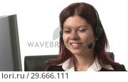 Купить «Stock Footage of Woman on Headset», видеоролик № 29666111, снято 15 февраля 2008 г. (c) Wavebreak Media / Фотобанк Лори
