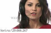 Купить «Stock Footage of a Woman Dancing», видеоролик № 29666267, снято 26 февраля 2008 г. (c) Wavebreak Media / Фотобанк Лори
