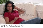 Купить «Woman Listening to Music 06», видеоролик № 29666275, снято 26 февраля 2008 г. (c) Wavebreak Media / Фотобанк Лори