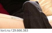 Купить «Woman on Sofa on Mobile Phone», видеоролик № 29666383, снято 26 февраля 2008 г. (c) Wavebreak Media / Фотобанк Лори