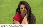 Купить «Woman Lying on Grass», видеоролик № 29666403, снято 26 февраля 2008 г. (c) Wavebreak Media / Фотобанк Лори