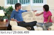 Купить «Young Couple on Sofa Arguing», видеоролик № 29666499, снято 1 марта 2008 г. (c) Wavebreak Media / Фотобанк Лори